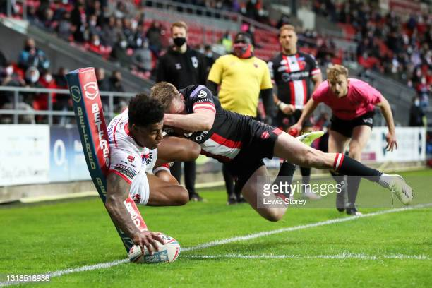 Kevin Naiqama of St Helens goes over to score his side's third try during the Betfred Super League match between St Helens and Salford Red Devils at...