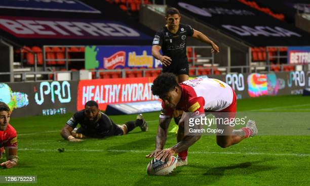 Kevin Naiqama of St Helens scores his team's third try during the Betfred Super League Play-Off Semi-Final between St Helens and Catalans Dragons at...