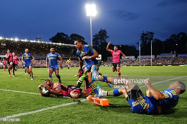 Kevin Naiqama of the Panthers puts his foot into touch as he tries to score with cover defence coming from Jarryd Hayne of the Eels during the round...