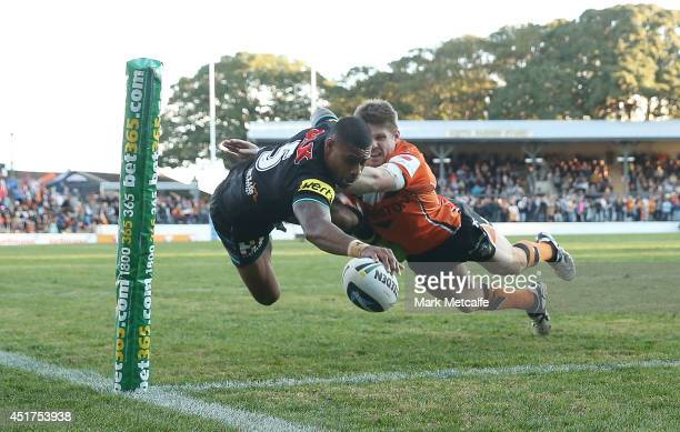 Kevin Naiqama of the Panthers scores a try during the round 17 NRL match between the Wests Tigers and the Penrith Panthers at Leichhardt Oval on July...