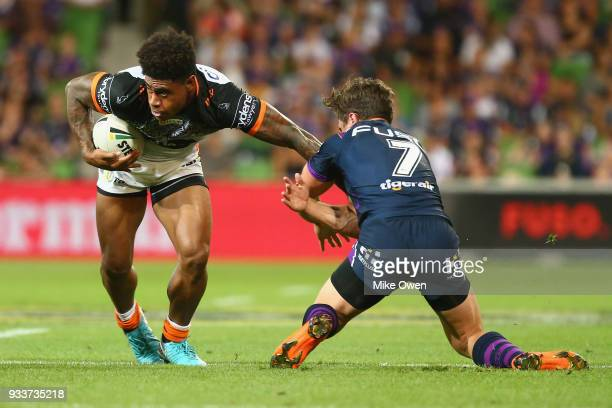 Kevin Naiqama of the Tigers breaks a takle from Brodie Croft of the Storm during the round two NRL match between the Melbourne Storm and the Wests...