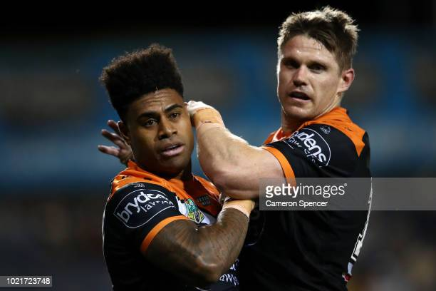 Kevin Naiqama of the Tigers celebrates scoring a try with team mate Chris Lawrence of the Tigers during the round 24 NRL match between the Wests...