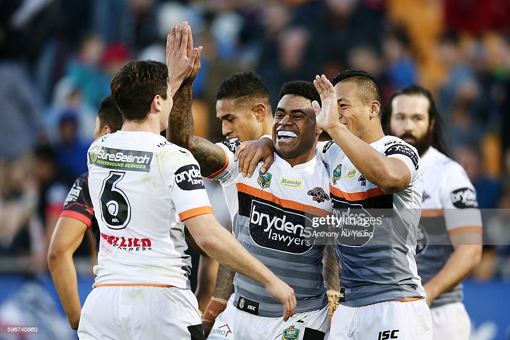 Kevin Naiqama of the Tigers celebrates with his teammates after scoring a try during the round 25 NRL match between the New Zealand Warriors and the Wests Tigers at Mount Smart Stadium on August 28, 2016 in Auckland, New Zealand.