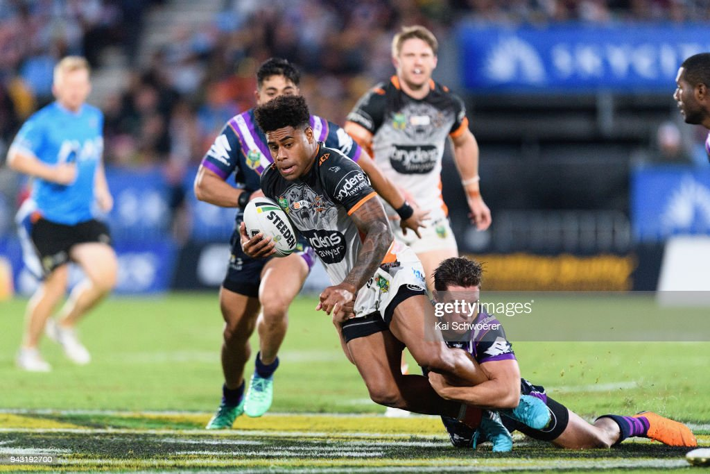 Kevin Naiqama of the Tigers is tackled by Brodie Croft of the Storm during the round five NRL match between the Wests Tigers and the Melbourne Storm at Mt Smart Stadium on April 7, 2018 in Auckland, New Zealand.