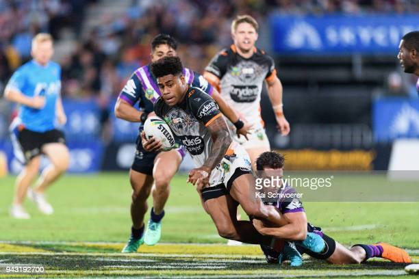 Kevin Naiqama of the Tigers is tackled by Brodie Croft of the Storm during the round five NRL match between the Wests Tigers and the Melbourne Storm...