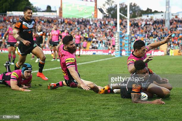 Kevin Naiqama of the Wests Tigers scores a try during the round 16 NRL match between the Wests Tigers and the Penrith Panthers at Leichhardt Oval on...