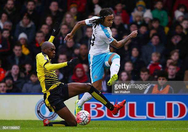 Kevin Nbabu of Newcastle United and AllanRomeo Nyom of Watford compete for the ball during the Emirates FA Cup Third Round match between Watford and...