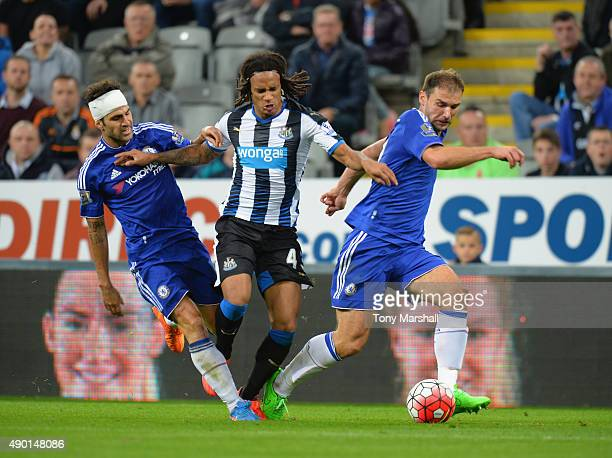 Kevin Nbabu of Newcastle United competes against Cesc Fabregas and Branislav Ivanovic of Chelsea during the Barclays Premier League match between...