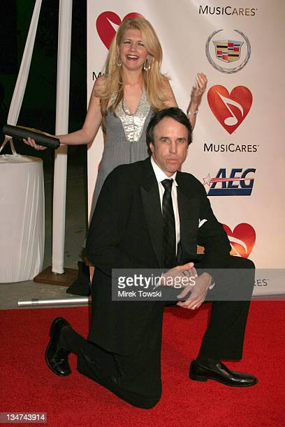 Kevin Nealon and his wife during 2006 Musicares Person of the Year James Taylor Arrivals at Los Angeles Convention Center in Los Angeles California...