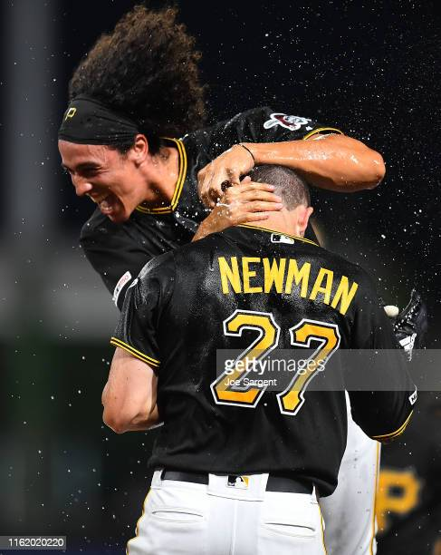 Kevin Newman of the Pittsburgh Pirates celebrates his game winning single with Cole Tucker during the ninth inning against the Chicago Cubs at PNC...