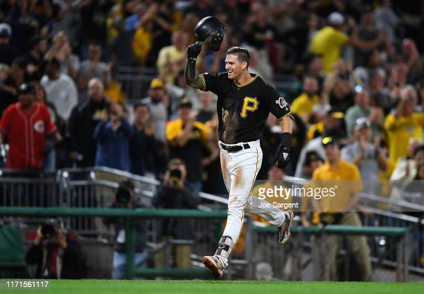 Kevin Newman of the Pittsburgh Pirates celebrates his two run home run during the ninth inning against the Cincinnati Reds at PNC Park on September...