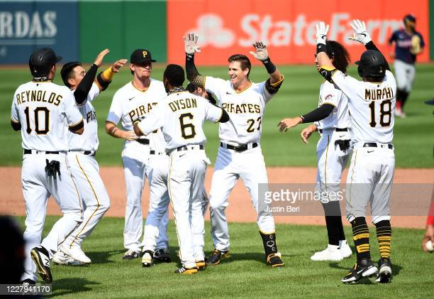 Kevin Newman of the Pittsburgh Pirates celebrates with teammates after hitting a walk-off two run single to give the Pirates a 6-5 win over the...