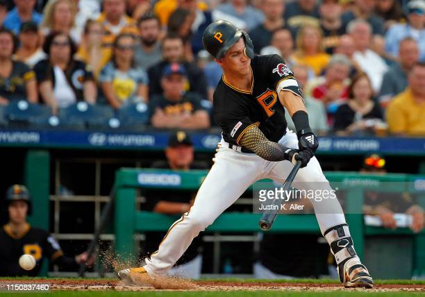 Kevin Newman of the Pittsburgh Pirates check swings against the Detroit Tigers during inter-league play at PNC Park on June 19, 2019 in Pittsburgh,...