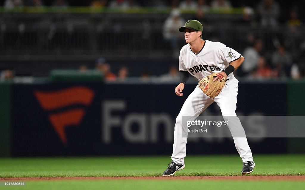 Kevin Newman #27 of the Pittsburgh Pirates makes his Major League Debut in the ninth inning during the game against the Chicago Cubs at PNC Park on August 16, 2018 in Pittsburgh, Pennsylvania.