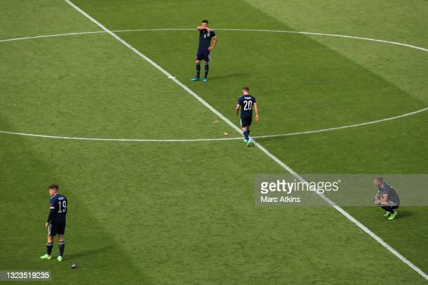 Kevin Nisbet, Grant Hanley, Ryan Fraser and Liam Cooper of Scotland look dejected following their team's defeat in the UEFA Euro 2020 Championship...