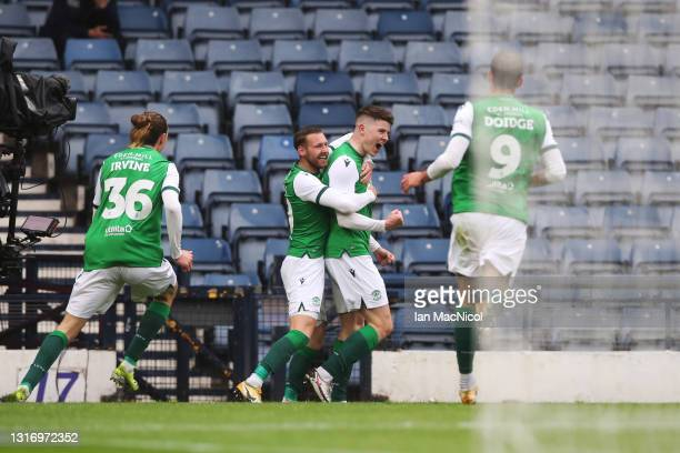 Kevin Nisbet of Hibernian FC celebrates with team mates after scoring their side's first goal during the William Hill Scottish Cup match between...