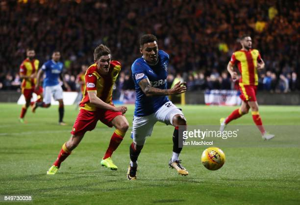 Kevin Nisbet of Partick Thistle vies with James Tavernier of Rangers during the Betfred League Cup Quarter Final at Firhill Stadium on September 19...