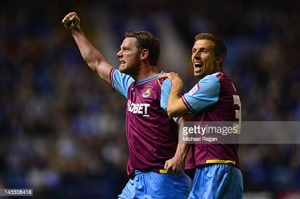 Kevin Nolan and Gary O'Neil of West Ham celebrate a goal by team mate Jack Collison to make it 21 during the npower Championship match between...