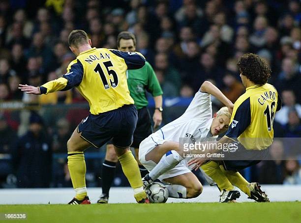 Kevin Nolan and Ivan Campo of Bolton Wanderers challenge Alan Smith of Leeds United for the ball during the FA Barclaycard Premiership game between...
