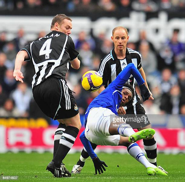 Kevin Nolan and Nicky Butt of Newcastle sandwich Jo of Everton during the Barclays Premier League match between Newcastle United and Everton at St...