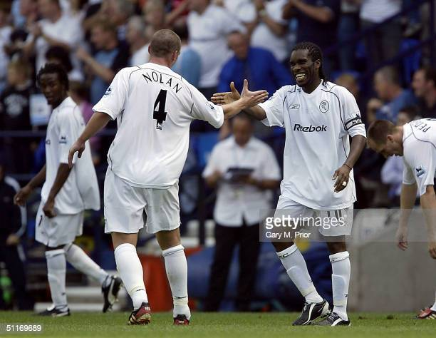 Kevin Nolan congratulates Jay Jay Okocha of Bolton Wanderers after scoring the third goal during the FA Barclays Premiership match between Bolton...