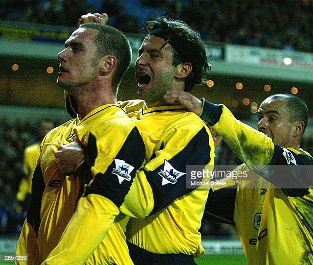 Kevin Nolan Javier Moreno and Stelios Giannakopoulos of Bolton celebrate the fourth and winning goal during the FA Barclaycard Premiership match...
