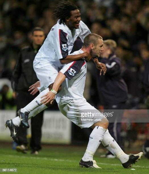 Kevin Nolan of Bolton celebrates his goal with team mate Ricardo Gardner during the Barclays Premiership match between Bolton Wanderers and Tottenham...