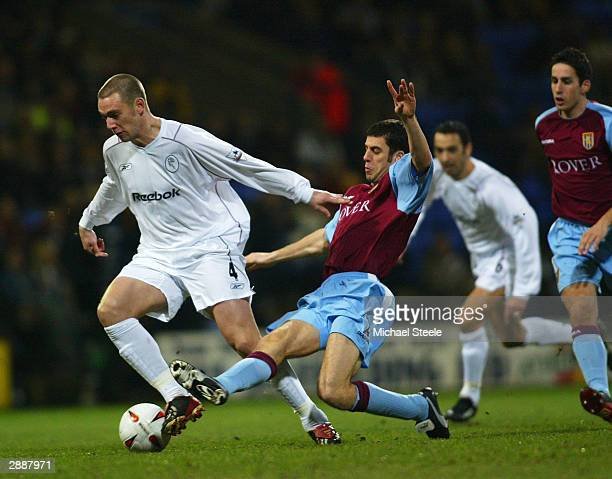 Kevin Nolan of Bolton goes past the challenge of Mark Delaney of Villa during the Carling Cup Semi-Final First Leg match between Bolton Wanderers and...