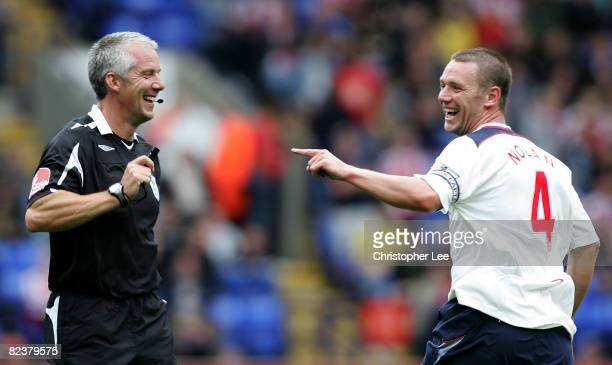 Kevin Nolan of Bolton jokes with referee Chris Foy during the Barclays Premier League match between Bolton Wanderers and Stoke City at The Reebok...