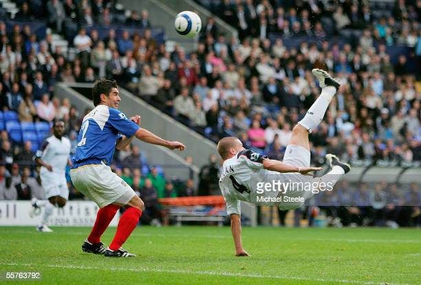 Kevin Nolan of Bolton scores with an overhead kick as Dejan Stefanovic of Portsmouth looks on during the Barclays Premiership match between Bolton...