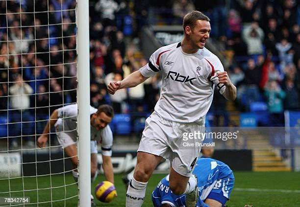 Kevin Nolan of Bolton Wanderers celebrates the first goal a Wigan Athletic own goal during the Barclays Premier League match between Bolton Wanderers...