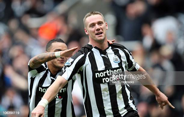 Kevin Nolan of Newcastle United celebrates with Danny Simpson after Nolan scoredthe first goal during the Barclays Premier League match between...