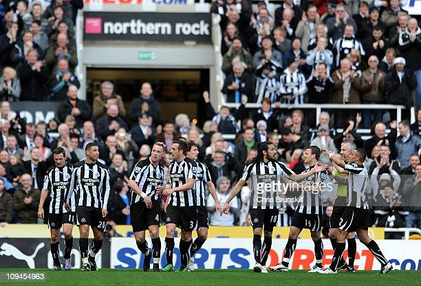 Kevin Nolan of Newcastle United is congratulated by his teammates after scoring the opening goal during the Barclays Premier League match between...