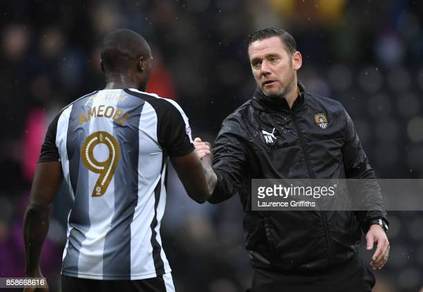 Kevin Nolan of Notts County congratulates Shola Ameobi after the Sky Bet League Two match between Notts County and Forest Green Rovers at Meadow Lane...