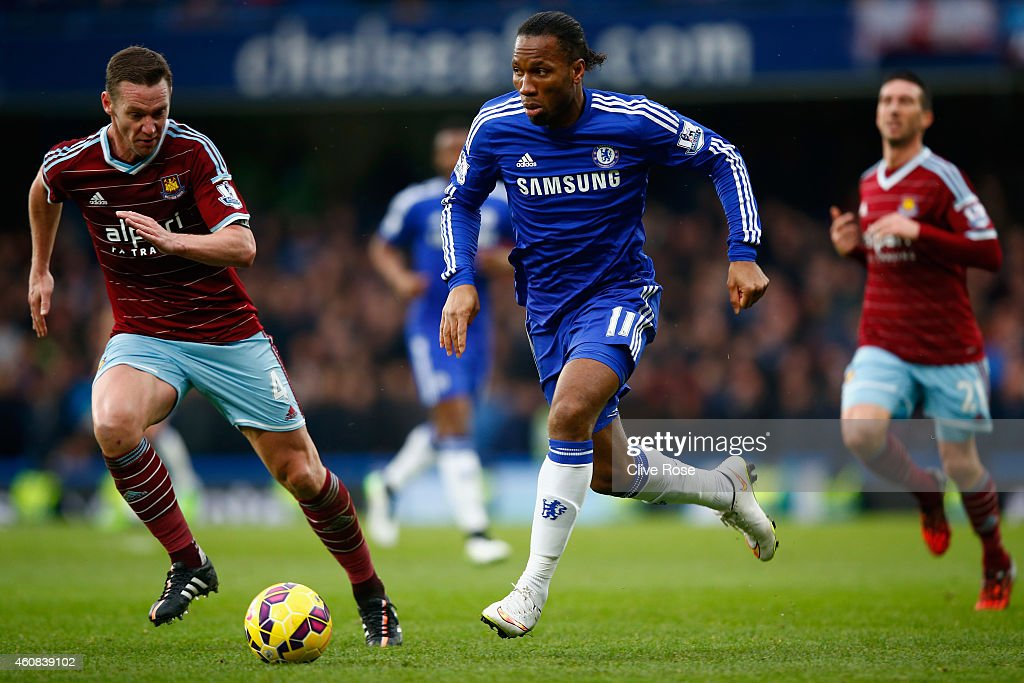 Kevin Nolan of West Ham marshalls Didier Drogba of Chelsea during the Barclays Premier League match between Chelsea and West Ham United at Stamford Bridge on December 26, 2014 in London, England.