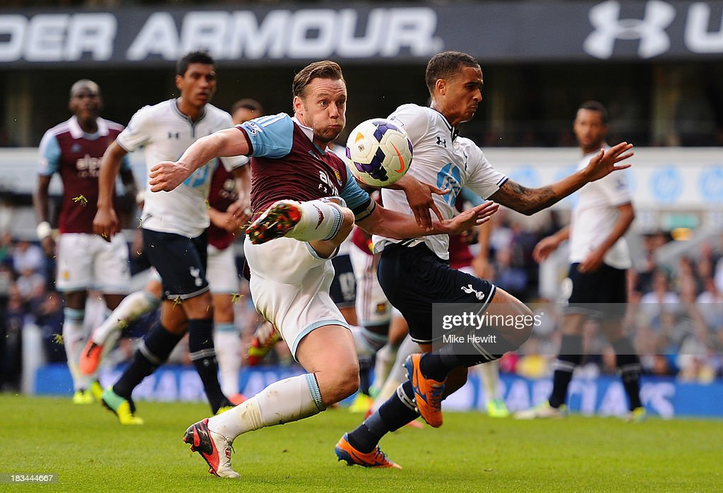 Kevin Nolan of West Ham shoots wide during the Barclays Premier League match between Tottenham Hotspur and West Ham United at White Hart Lane on October 6, 2013 in London, England.