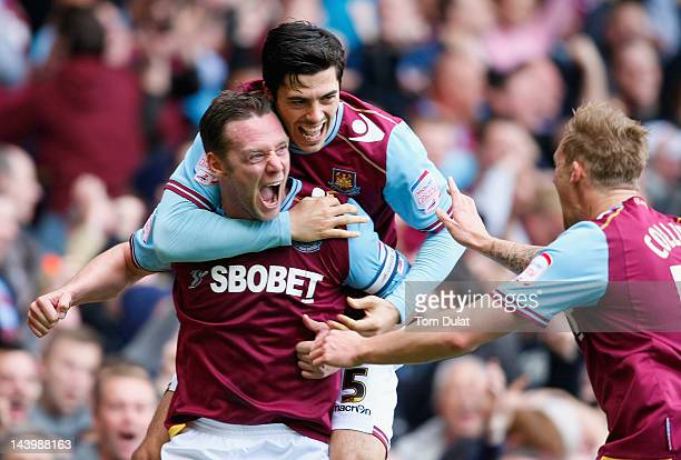 Kevin Nolan of West Ham United celebrates scoring the opening goal with team mate James Tomkins during the nPower Championship Playoff Semi Final 2nd...