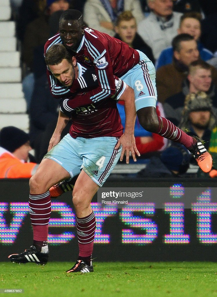 Kevin Nolan of West Ham United (L) celebrates with team mate Cheikhou Kouyate as he scores their first and equalising goal during the Barclays Premier League match between West Bromwich Albion and West Ham United at The Hawthorns on December 2, 2014 in West Bromwich, England.