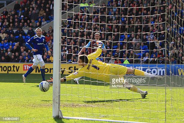 Kevin Nolan of West Ham United scores the first goal as goalkeeper David Marshall dives in vain during the npower Championship match between Cardiff...