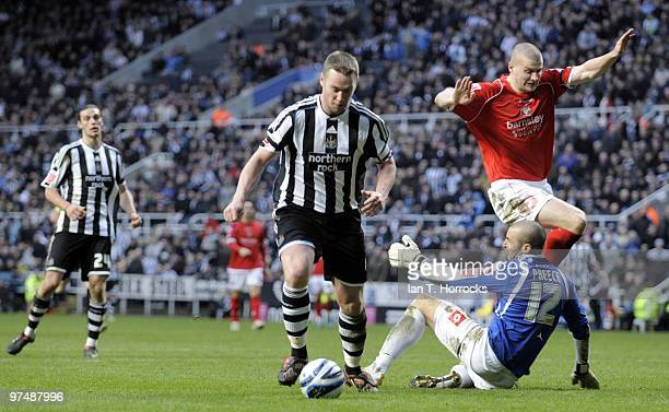Kevin Nolan rounding stand in keeper David Preece to score the sixth goal during the CocaCola championship match between Newcastle United and...