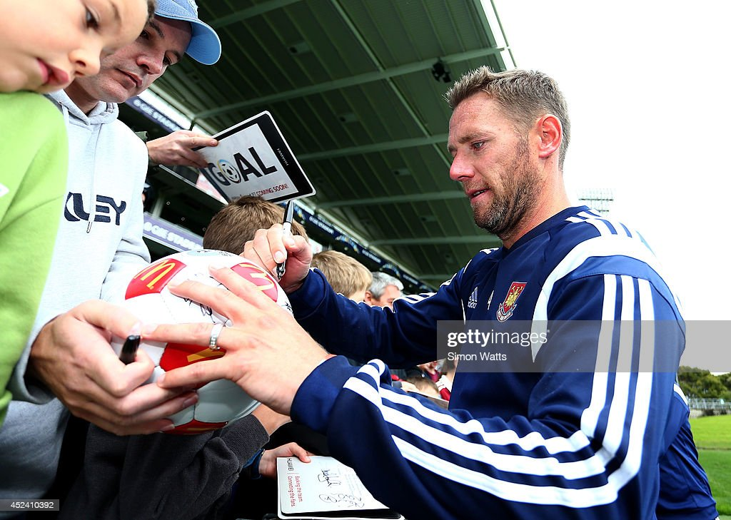 Kevin Nolan signs autographs during a West Ham United training session at North Harbour Stadium on July 20, 2014 in Auckland, New Zealand.