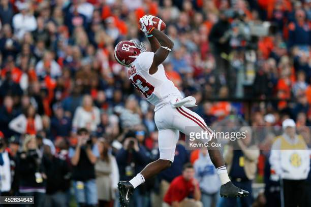 Kevin Norwood of the Alabama Crimson Tide catches a second quarter touchdown pass against the Auburn Tigers at Jordan-Hare Stadium on November 30,...