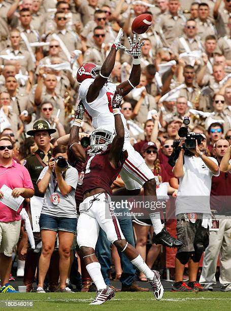 Kevin Norwood of the Alabama Crimson Tide makes a catch for a touchdown over De'Vante Harris of the Texas AM Aggies in the first quarter at Kyle...