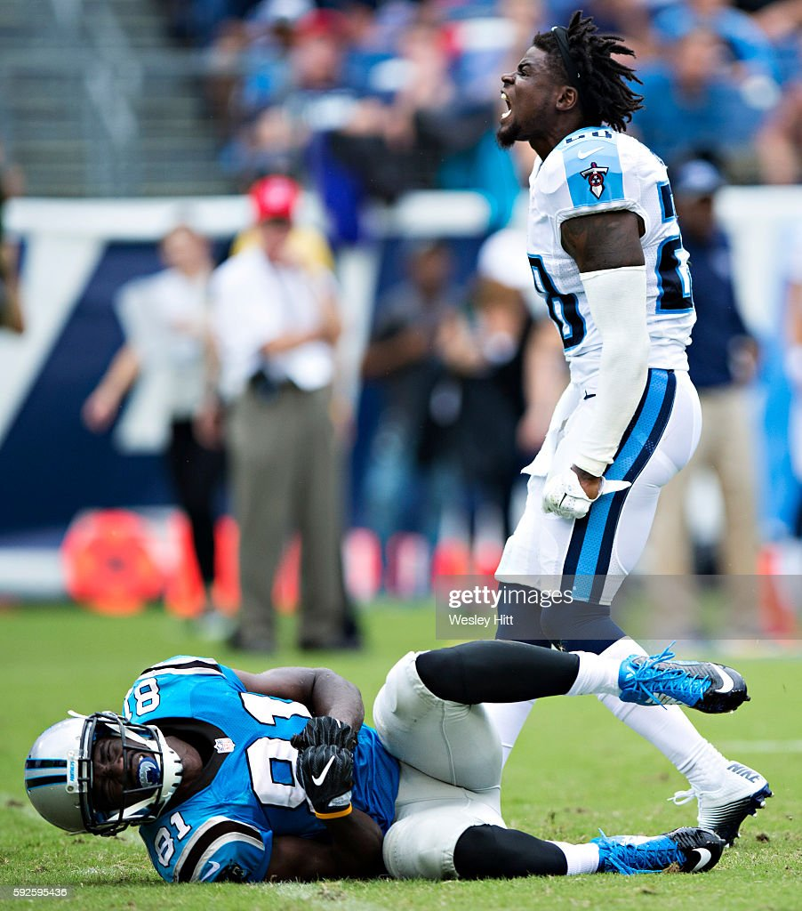 Kevin Norwood #81 of the Carolina Panthers hits the ground in pain after being hit by Marqueston Huff #28 of the Tennessee Titans during a preseason game at Nissan Stadium on August 20, 2016 in Nashville, Tennessee.
