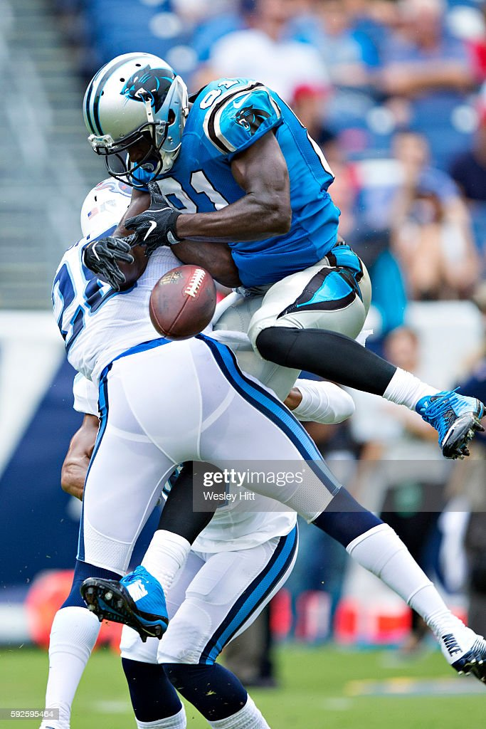Kevin Norwood #81 of the Carolina Panthers is hit trying to catch a pass by Marqueston Huff #28 of the Tennessee Titans during a preseason game at Nissan Stadium on August 20, 2016 in Nashville, Tennessee.