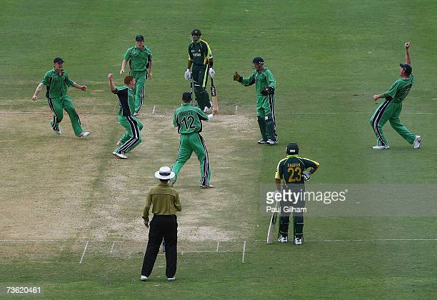 Kevin O'Brien celebrates withh his teammates after taking the wicket of Shoaib Malik of Pakistan for nine runs after he was caught behind by Niall...