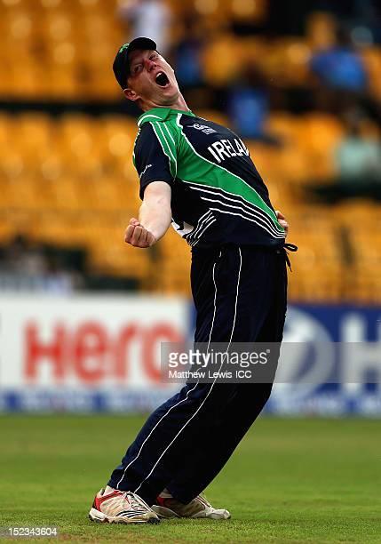 Kevin O'Brien of Ireland celebrates catching David Warner of Australia during the ICC World Twenty20 Group B match between Australia and Ireland at...
