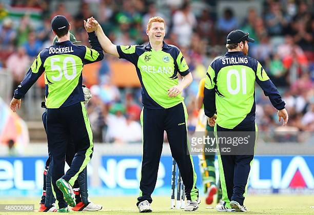 Kevin O'Brien of Ireland celebrates getting the wicket of Francois Du Plessis of South Africa during the 2015 ICC Cricket World Cup match between...