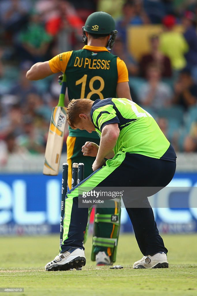 Kevin O'Brien of Ireland celebrates taking the wicket of Faf du Plessis of South Africa during the 2015 ICC Cricket World Cup match between South Africa and Ireland at Manuka Oval on March 3, 2015 in Canberra, Australia.