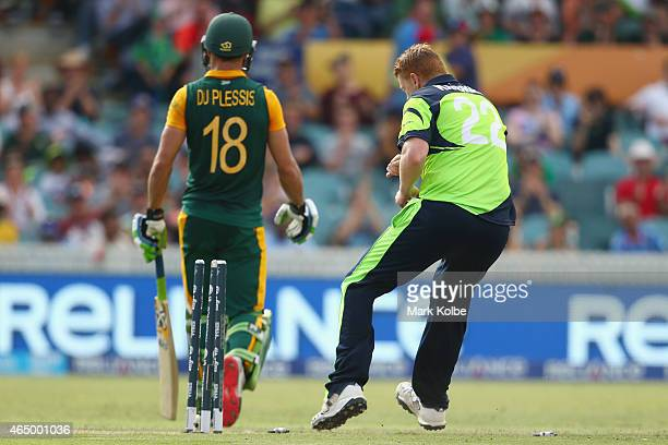 Kevin O'Brien of Ireland celebrates taking the wicket of Faf du Plessis of South Africa during the 2015 ICC Cricket World Cup match between South...